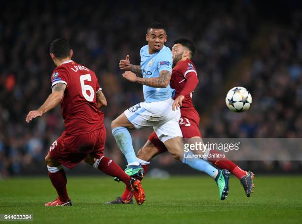 Gabriel Jesus of Manchester City battles for posession with Dejan Lovren and Alex OxladeChamberlain of Liverpool during the Quarter Final Second Leg...
