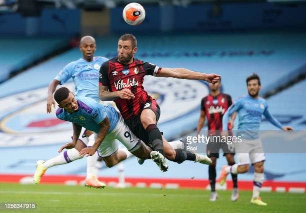Gabriel Jesus of Manchester City battles for possession in the air with Steve Cook of AFC Bournemouth during the Premier League match between...