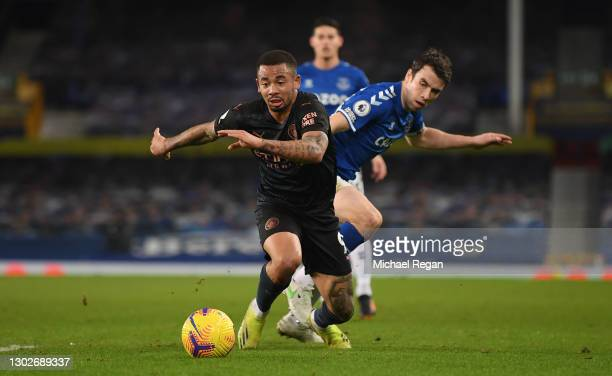 Gabriel Jesus of Manchester City battles for possession with Seamus Coleman of Everton during the Premier League match between Everton and Manchester...