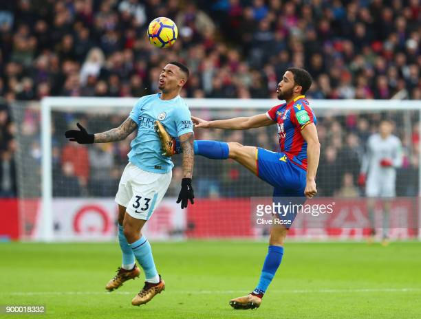 Gabriel Jesus of Manchester City battles with Andros Townsend of Crystal Palace during the Premier League match between Crystal Palace and Manchester...
