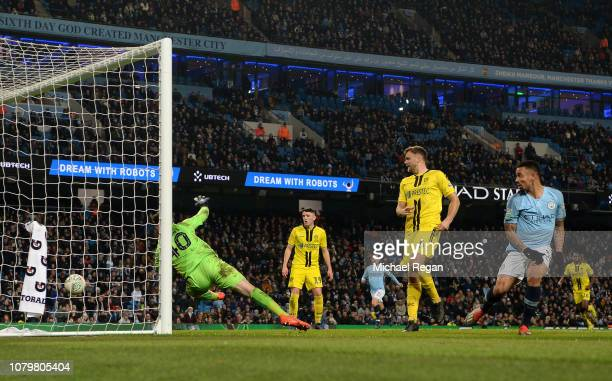Gabriel Jesus of Manchester City beats Bradley Collins of Burton Albion as he scores his team's seventh goal during the Carabao Cup Semi Final First...