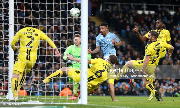 Gabriel Jesus of Manchester City beats the Burton Albion defence as he scores his team's second goal during the Carabao Cup Semi Final First Leg...
