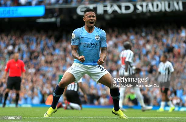 Gabriel Jesus of Manchester City celebates his sides first goal during the Premier League match between Manchester City and Newcastle United at...