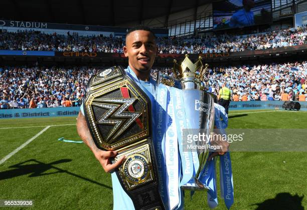 Gabriel Jesus of Manchester City celebrate with The Premier League Trophy and a WWE belt after the Premier League match between Manchester City and...