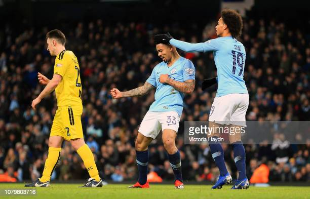 Gabriel Jesus of Manchester City celebrates after scoring his team's third goal with team mate Leroy Sane during the Carabao Cup Semi Final First Leg...