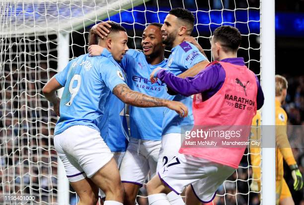 Gabriel Jesus of Manchester City celebrates after scoring his teams third goal with team mates during the Premier League match between Manchester...