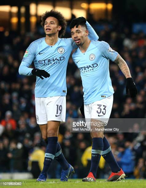 Gabriel Jesus of Manchester City celebrates as he scores his team's fifth goal and completes his hat trick with Leroy Sane during the Carabao Cup...