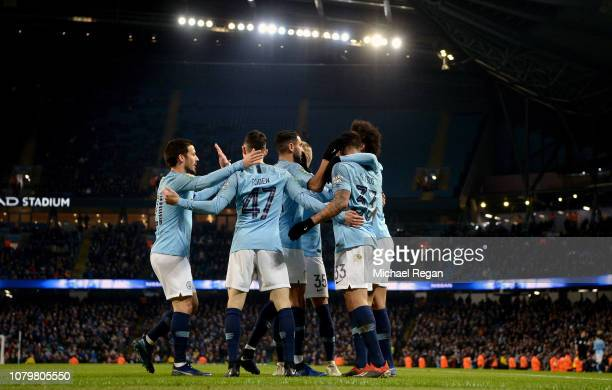 Gabriel Jesus of Manchester City celebrates as he scores his team's seventh goal with team mates during the Carabao Cup Semi Final First Leg match...