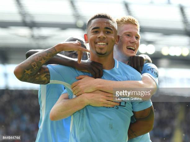 Gabriel Jesus of manchester City celebrates his goal with Benjamin Mendy and Kevin De Bruyne during the Premier League match between Manchester City...