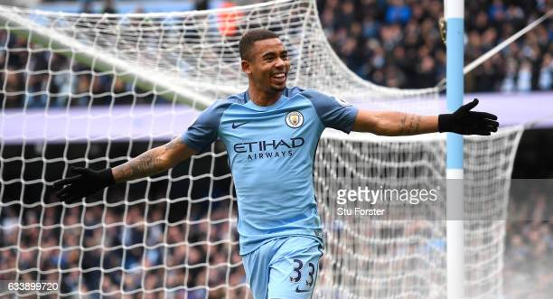 Gabriel Jesus of Manchester City celebrates scoring his sides first goal during the Premier League match between Manchester City and Swansea City at...