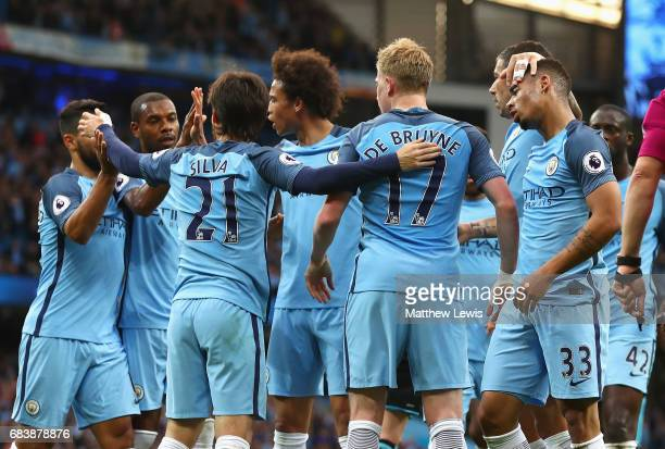 Gabriel Jesus of Manchester City celebrates scoring his sides first goal with his Manchester City team mates during the Premier League match between...
