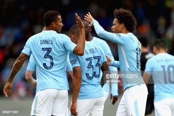 Gabriel Jesus of Manchester City celebrates scoring his sides first goal with Danilo of Manchester City and Leroy Sane of Manchester City during a...