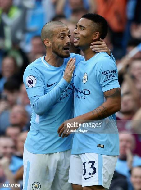 Gabriel Jesus of Manchester City celebrates scoring his sides first goal with David Silva of Manchester City during the Premier League match between...