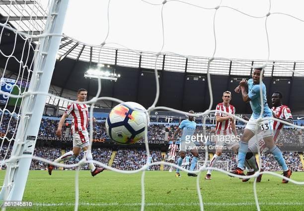 Gabriel Jesus of Manchester City celebrates scoring his sides first goal during the Premier League match between Manchester City and Stoke City at...