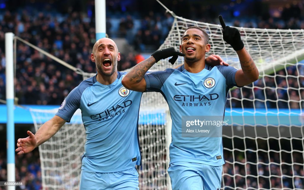 Gabriel Jesus of Manchester City (R) celebrates scoring his sides second goal with Pablo Zabaleta during the Premier League match between Manchester City and Swansea City at Etihad Stadium on February 5, 2017 in Manchester, England.