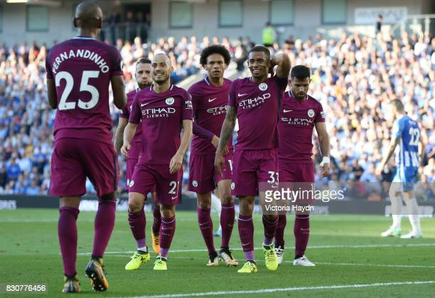 Gabriel Jesus of Manchester City celebrates scoring his sides second goal with his Manchester City team mates during the Premier League match between...