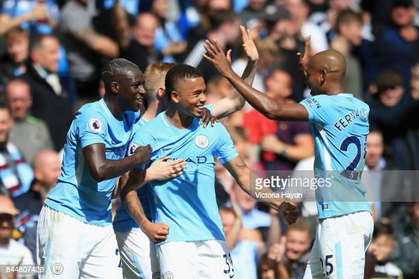 Gabriel Jesus of Manchester City celebrates scoring his sides second goal with Benjamin Mendy of Manchester City and Fernandinho of Manchester City...