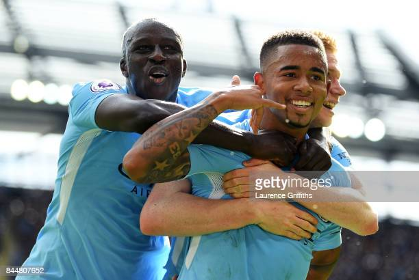 Gabriel Jesus of Manchester City celebrates scoring his sides second goal with Benjamin Mendy of Manchester City during the Premier League match...