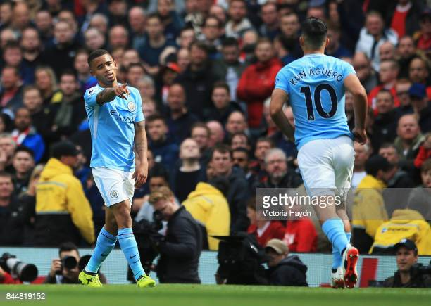 Gabriel Jesus of Manchester City celebrates scoring his sides third goal with Sergio Aguero of Manchester City during the Premier League match...