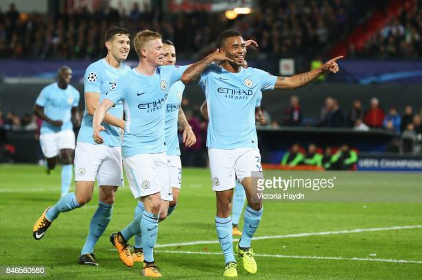 Gabriel Jesus of Manchester City celebrates scoring his sides third goal with Kevin De Bruyne of Manchester City during the UEFA Champions League...