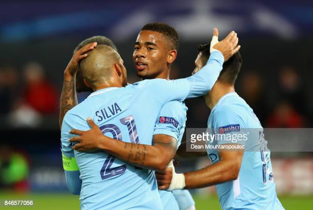 Gabriel Jesus of Manchester City celebrates scoring his sides third goal with David Silva of Manchester City during the UEFA Champions League group F...