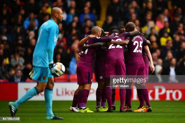 Gabriel Jesus of Manchester City celebrates scoring his sides third goal with his Manchester City team mates during the Premier League match between...