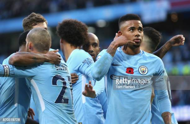 Gabriel Jesus of Manchester City celebrates scoring his sides third goal during the Premier League match between Manchester City and Arsenal at...