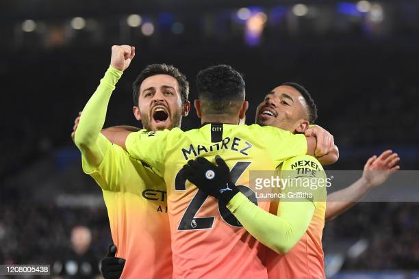 Gabriel Jesus of Manchester City celebrates with Bernardo Silva and Riyad Mahrez after scoring his team's first goal during the Premier League match...