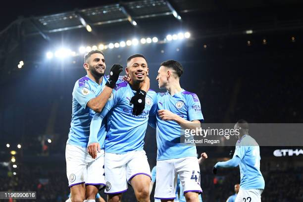 Gabriel Jesus of Manchester City celebrates with his team after he scores his sides first goal during the Premier League match between Manchester...