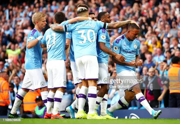 Gabriel Jesus of Manchester City celebrates with his team after scoring his sides third goal which is later disallowed by VAR during the Premier...