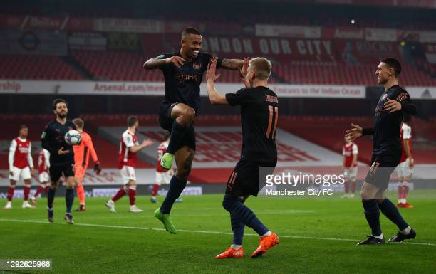 Gabriel Jesus of Manchester City celebrates with Oleksandr Zinchenko after scoring their team's first goal during the Carabao Cup Quarter Final match...