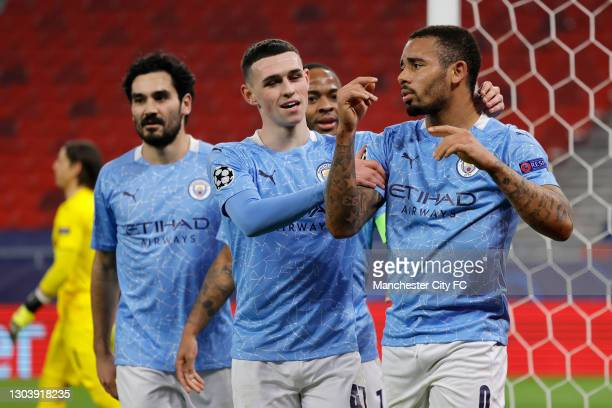 Gabriel Jesus of Manchester City celebrates with Phil Foden after scoring their team's second goal during the UEFA Champions League Round of 16 match...