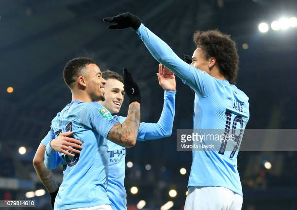 Gabriel Jesus of Manchester City celebrates with Phil Foden and Leroy Sane as he scores his team's seventh goal during the Carabao Cup Semi Final...