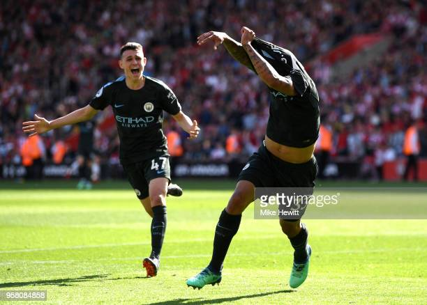 Gabriel Jesus of Manchester City celebrates with Phil Foden of Manchester City after scoring his sides first goal during the Premier League match...