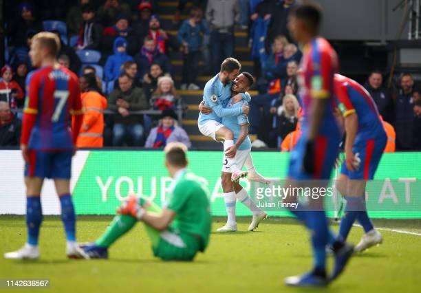 Gabriel Jesus of Manchester City celebrates with team mate Bernardo Silva as he scores his team's third goal during the Premier League match between...