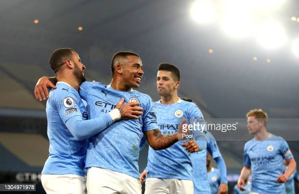 Gabriel Jesus of Manchester City celebrates with team mate Kyle Walker after scoring their side's second goal during the Premier League match between...