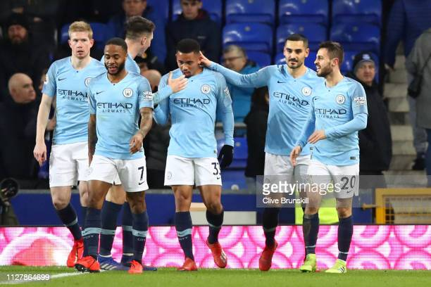 Gabriel Jesus of Manchester City celebrates with team mates after he scores his sides second goal during the Premier League match between Everton FC...