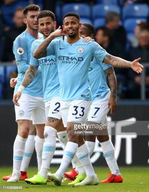 Gabriel Jesus of Manchester City celebrates with team mates as he scores his team's third goal during the Premier League match between Crystal Palace...