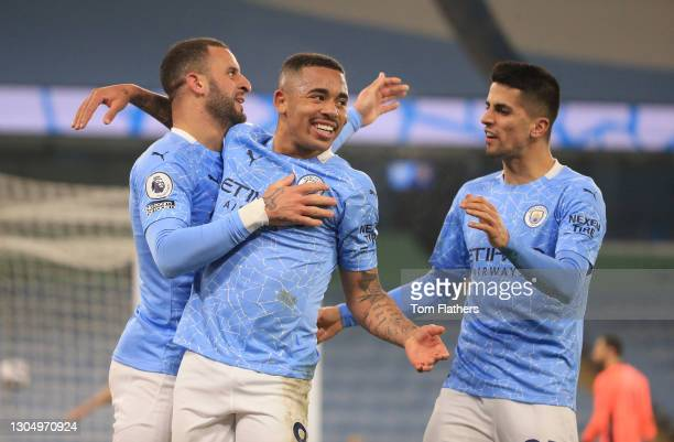Gabriel Jesus of Manchester City celebrates with team mates Joao Cancelo and Kyle Walker after scoring their side's second goal during the Premier...