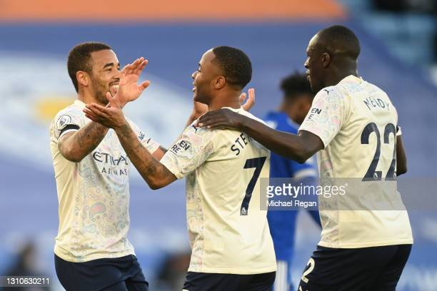 Gabriel Jesus of Manchester City celebrates with team mates Raheem Sterling and Benjamin Mendy after scoring their side's second goal during the...