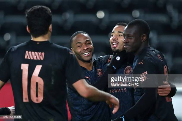 Gabriel Jesus of Manchester City celebrates with team mates Rodrigo, Raheem Sterling and Benjamin Mendy after scoring their side's third goal during...