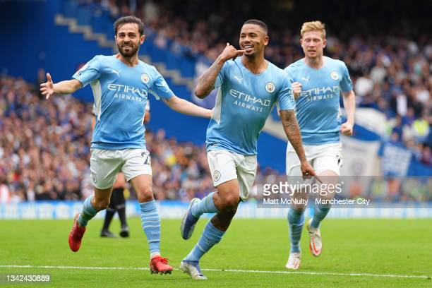 Gabriel Jesus of Manchester City celebrates with teammate Bernardo Silva after scoring their team's first goal during the Premier League match...
