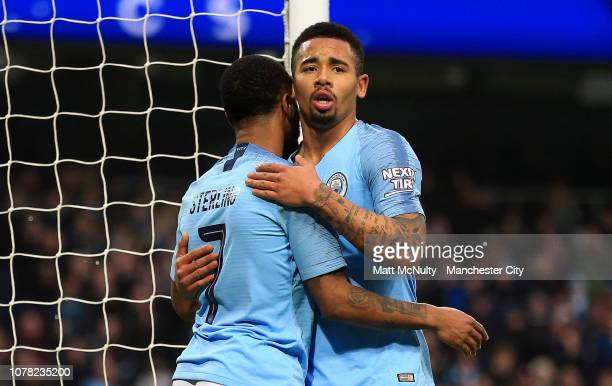 Gabriel Jesus of Manchester City celebrates with teammate Raheem Sterling after scoring his team's fourth goal during the FA Cup Third Round match...