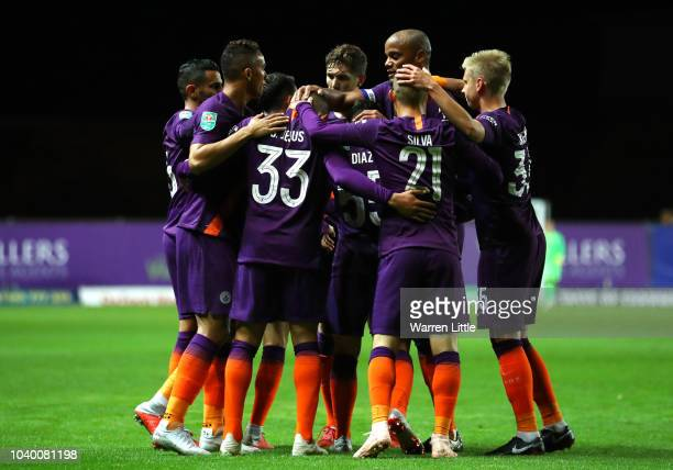 Gabriel Jesus of Manchester City celebrates with teammates after scoring his team's first goal during the Carabao Cup Third Round match between...
