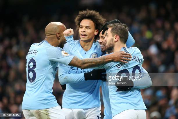 Gabriel Jesus of Manchester City celebrates with teammates after scoring his team's first goal during the Premier League match between Manchester...