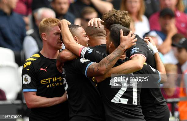 Gabriel Jesus of Manchester City celebrates with teammates after scoring his team's first goal during the Premier League match between West Ham...