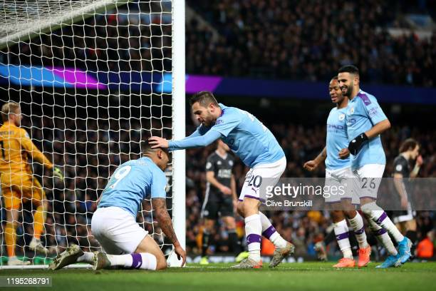 Gabriel Jesus of Manchester City celebrates with teammates after scoring his team's third goal during the Premier League match between Manchester...