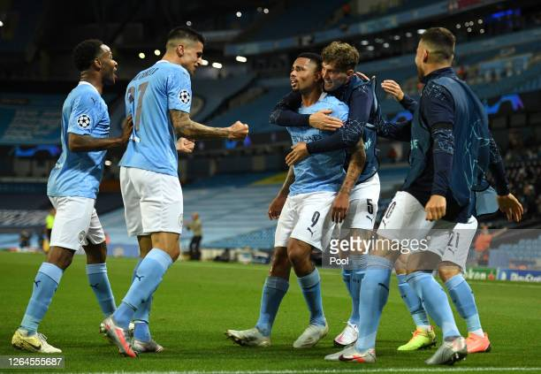 Gabriel Jesus of Manchester City celebrates with teammates after scoring his team's second goal during the UEFA Champions League round of 16 second...