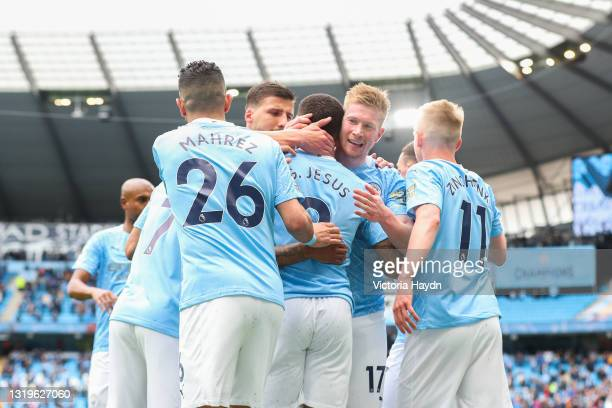 Gabriel Jesus of Manchester City celebrates with teammates after scoring his team's second goal during the Premier League match between Manchester...