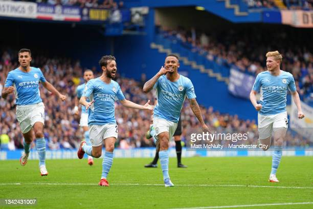 Gabriel Jesus of Manchester City celebrates with teammates Bernardo Silva and Kevin De Bruyne after scoring their team's first goal during the...